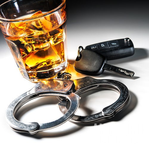 handcuffs, keys, and alcohol