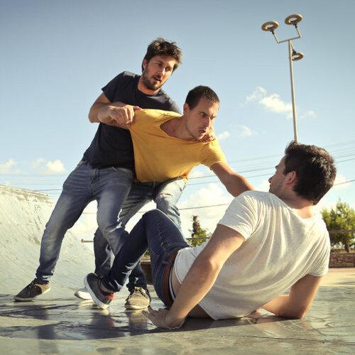 Three men fighting.