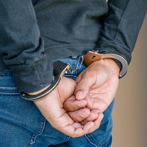 Man in handcuffs.