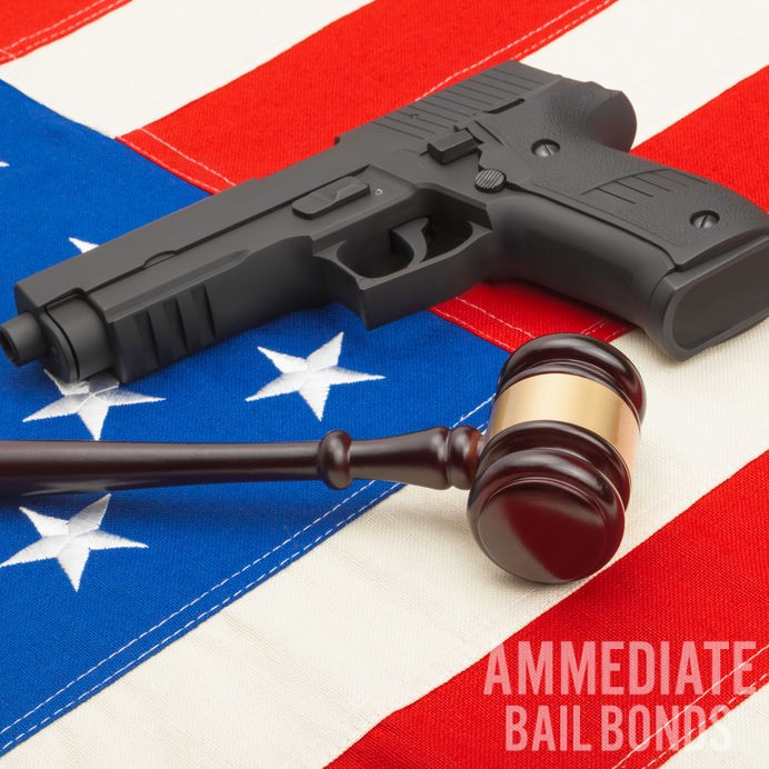 Wooden judge gavel and gun over USA flag