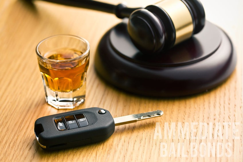 A Picture of a Shot Glass, Car Keys, and Gavel.